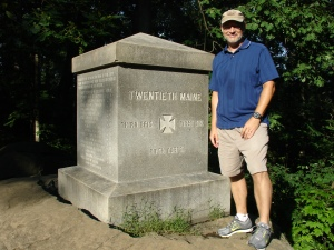 Yours truly beside the memorial to the 20th Maine Inf. on the southern slope of Little Round Top.